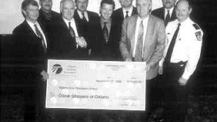 BIG CHEQUE: The Ontario Trucking Association presents $25,000 to Crime Stoppers for a special truck theft initiative. (Photo by John G. Smith)