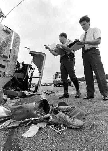 WRECK CHECK: Investigators on the scene of the crash.(Canapress photo)