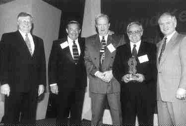 Pictured from left: Paul Skoog, Kenworth assistant general manager for sales; Leigh Parket, Jim Beiderwieden, Dick McCon-nochie of Inland Kenworth; and Ed Caudill, Kenworth general manager/PACCAR vice-president