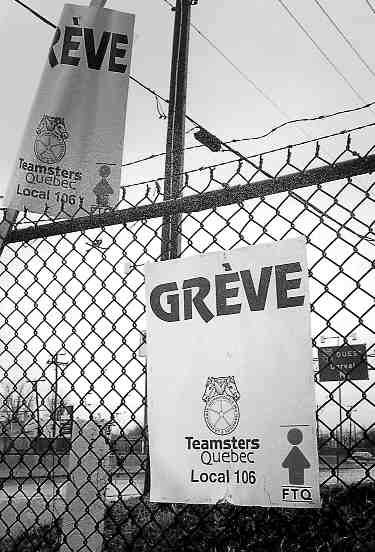 SIGNS OF PROTEST: Teamsters make their mark in Dorval.