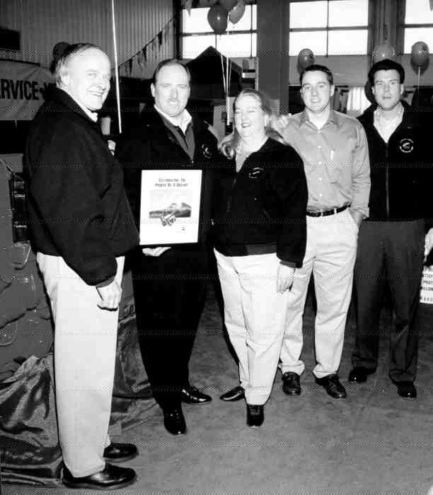 HAPPY 20TH: Cummins Alberta owners Ed and Paige Stahl collect a 20th anniversary plaque from Cummins' Ron Wilson (second from left), while Greg and Eddy Stahl look on. The anniversary was celebrated on April 29 by 1,490 guests - 80 of whom took the opportunity to road test trucks brought by participating heavy-truck dealers. Also on display were a series of Cummins-powered antique trucks, on loan from Ed Prodor of the American Truck Historical Society's Alberta chapter.