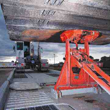 ROLLING ON RAILS: A special fifth-wheel holds its highway trailer in place.(CPR photo)