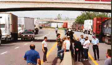THE COST OF DEFIANCE: Quebec demonstrations such as this 1998 blockade near the Ontario border will soon carry a cost. (Photo by Carroll McCormick)
