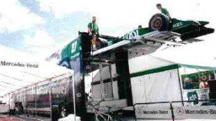 LIFT TRUCKS: Team Kool Green crew members unload one of their cars from its lofty compartment. (Photo by John G. Smith)