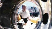 SHINE ON: Rick Towne cleans up Honda's equipment. (Photo by John G. Smith)