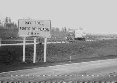 A SIGN OF THE PAST: Tolls are gone, and tollbooths will go as well.