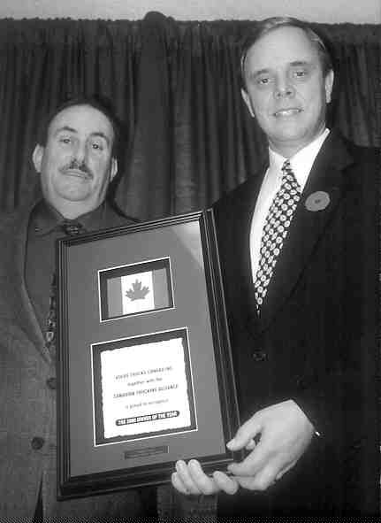 WINNING SMILE: Canadian Trucking Alliance/ Volvo Trucks Canada National Driver of the Year Barry Enman (left) receives his award fromBrent Weary, Volvo Trucks Canada vice-president, sales and marketing.