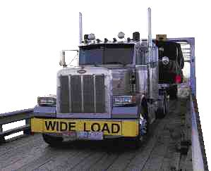 BIG TIME: A Watt & Stewart Pete glides along with yet another load of large Michelin tires.(Photo by Peterbilt)