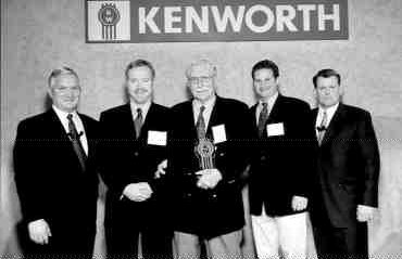 TOP SHOP: Edmonton Kenworth was recently named Kenworth's Canadian Dealer of Year. From left, Ed Caudill, Kenworth general manager and Paccar vice-president; Edmonton Kenworth's Gary King, Mike King and Colin Ferguson; and Tony McQuary, Kenworth assistant general manager for sales and service.