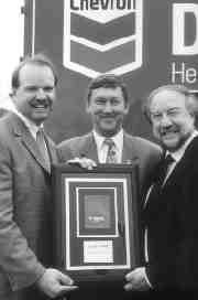 SLICK JOB: Chevron sales manager, Tony Arado, left, presents Tribospec's Richard Allard and Julian Cininni with the silver award.