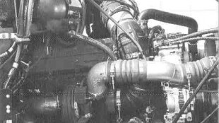 HOW IT'S PLUMBED: Seen here is Cummins' answer to the EPA. A: The start of the EGR equipment. B: The variable geometry turbo and control valve.