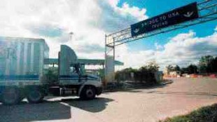 STRANDED: Differences between Canadian and U.S. policies leave truckers dangling in the middle.