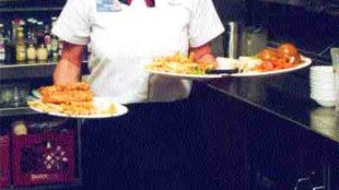 DINNER TIME: Dingwell's job as a server is a constant juggling act.