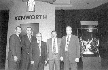 RECOGNITION: Inland Kenworth Ltd. in B.C. was named 2002 Kenworth Dealer of the Year. From left are: Chris Braun, Bob Christensen, Dick McConnachie, Leigh Parker and Jim Beiderwieden.
