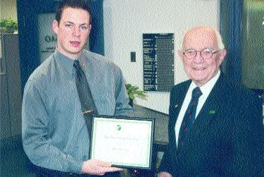 IN PURSUIT OF EXCELLENCE: Bud Barr (right) of the OTA presents the 2002 scholarship to James McCracken (left).