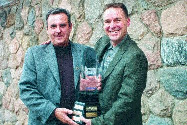 TOP WRENCH: Ed Roeder (right) receives the 2003 Maintenance Manager of the Year award, and congratulations from last year's winner, Bill Dinino (left).