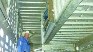 HANGING ON: Livestock trucker Mark Wendorff, pictured with daughter, Shyan and son Casee.Photo reprinted with permission from The Calgary Herald