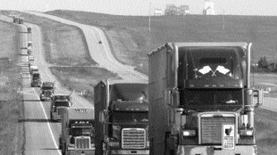 SOLIDARITY: Livestock truckers in Alberta form a convoy en route to the U.S. border in protest.Photo reprinted with permission from The Calgary Herald