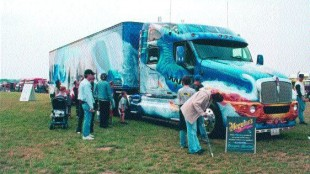 "SLEEPING BEAUTY: Airbrushed, prepped and buffed for nearly 4,000 hours, at a total cost of $130,000, the ""Dragon Master"" laid claim to being""the most detailed truck in the world."" It certainly drew a crowd. Photo by Ingrid Phaneuf"