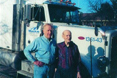 OLD FRIENDS: Ross Mackie (left) visited with former trucker Rudy Croissant.