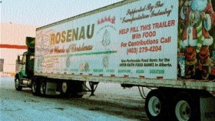 SPIRIT OF GIVING: This trailer, donated by Rosenau Transport, was driven throughout Alberta, collecting food donations from transport companies. Photo by Evalee Sommerfeldt