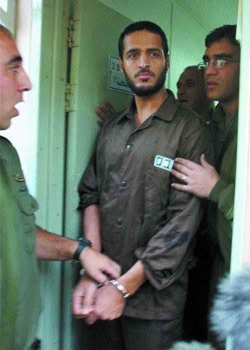 TERROR THREAT?: Jamal Akkal is escorted into Israeli military court. Photo with permission of Canadian Press