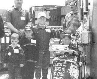 SPIRIT: Children of some of the truckers involved in last year's Teddy Bear Convoy presented Nicholas (his last name withheld) with a miniature truck.
