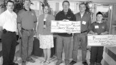 ST. JOHN'S, NFLD.: The 2004 Teddy Bear Convoy raised over $20,000 for the Janeway Children's Hospital of St John's, Nfld.On June 6 over 60 trucks circled the hospital to show support during this year's Janeway Telethon.(LtoR) Robert Wiseman of the Transportation Club of Newfoundland; Wilbert Collins of the Newfoundland and Labrador Independent Truckers Association and the organizer of the Convoy; Claudette Barnes, Telethon Host; Tom Rideout, Minister of Transportation and Works; Gord Peddle of the Newfoundland and Labrador Carriers Association; Mitchell Collins.n