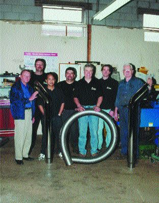 TEAMWORK: The employees of Star Exhaust Systems.