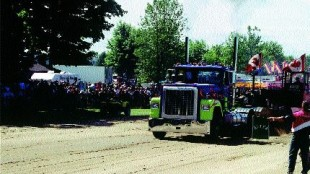 PULLING AHEAD: The roar of truck pull engines and the crowd supplied the show's soundtrack.
