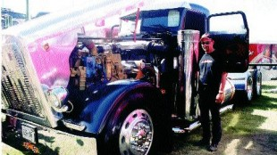 NO SECRETS: Show and Shine entrant Carl Boice wasn't afraid to show one and all what was under the hood of his 1990 Peterbilt.