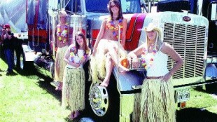 HULA TRUCK: This Pete got hula girls Julie Gerbes, Lara Wallace, Janelle Davenport and Mikelle Forrest dancin'.