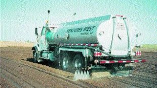 SEASONAL: Spraying roads with calcium chloride is another of Venture West's specialties. Bauer got his start in the trucking business with a single truck and trailer hauling calcium chloride.