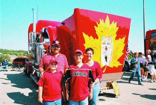 MAPLE LEAF PRIDE: A Canadian was a winner in several categories at the Richard Crane Memorial Truck Show in St. Ignace, Mich. in September. Pierre and Kerry Lee Cinq-Mars, sons Mitchel (youngest) and Matthew from Iron Bridge, Ont. (pictured above) and their truck came in second place (a tie) in Display, Engine, Bobtail Mural, placed third in Bobtail Lights, and came in first in the '02 or newer Bobtail ('02 Western Star) lights category. Congratulations! Photo by Bill Hudgins