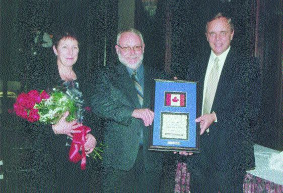 AWARD WINNER: Driver Georges Leblanc (centre) has 33 years of experience.
