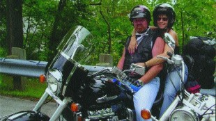 LOVEBIRDS: Ken and Kathy Gibbs try to celebrate Valentine's Day every day of the year. The two last year travelled to the Port Dover Friday the 13th bike fest on their new motorcycle. They hope to make it there again this year. Photo courtesy of Kathy Gibbs