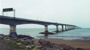 BRIDGE THE DISTANCE: The Eastern Canadian provinces have overcome geographical barriers with the Confederation bridge, but now they must merge on trucking regulation issues. Photo by Katy de Vries