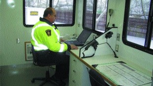 COMMAND CENTRE: Inspector Dale Howard demonstrates the vehicle's many functions.Photo by James Menzies