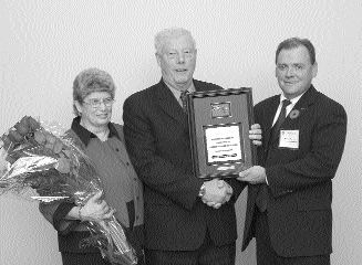OOPS: In the January 2005 issue of Truck News the wrong picture was printed for Wayne Dixon, who is shown here (middle) accepting the 2004 Volvo Trucks Canada Driver of the Year Award at the Ontario Trucking Association's annual convention held at the Toronto Congress Centre.