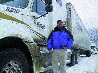 STRANDED: Bison Transport driver, Norman Monkman, opted to rent a room rather than keep his truck idling for days at a time.