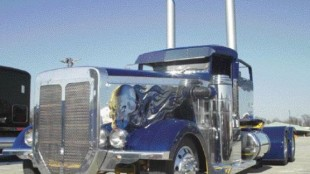 """HOMETOWN COMPETITOR: Quality Custom of Brampton, Ont.'s entry """"Singled out"""" with chopped can and peekaboo hood cut out took third in the Mid-America Trucking Show's first annual truck build off."""