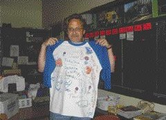 ROLE MODEL: Trucker Buddy Gerry Dressler proudly shows off a shirt designed for him by students from Buffalo Public School #82Photo by Donna Haivland