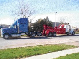 COSTLY: Getting a semi towed isn't a cheap proposition, but not all tow truck drivers are out to screw you over.  Photo courtesy of Abrams