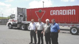 THE CREW: (Pictured left to right) Jim Zborowsky, Di-Mond Trailers Inc.; Rob Turner, fleet maintenance manager, Canadian Tire; Joe Monaco, general manager, Di-Mond Trailers Inc.; and Pat DiLillo, owner, Di-Mond Trailers Inc.Photo by Adam Ledlow