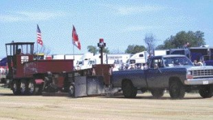 "LEAD: Four-wheelers got in on the action at Fergus, like this 1984 Dodge Ram which came up just short of a 300 ft. ""full-pull"" during the truck pull competition.Photo by Adam Ledlow"