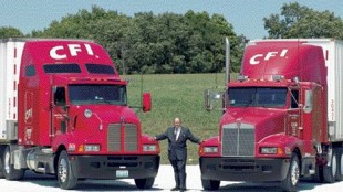CONVERTED: Kenworth's first T600 fleet customer was Contract Freighters Inc. (CFI) in Joplin, Mo. CFI chairman and CEO Glenn Brown is shown here with the company's original T600 purchased in 1985, at right, and one of the company's new 2006 Model T600s with new cab interior, at left. CFI has more than 1,600 Kenworth T600s in its fleet today.
