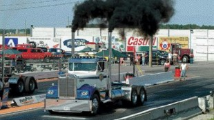 READY, SET...: A Kenworth dragster puts the pedal to the metal. A wide variety of trucks took to the drag strip in anger.