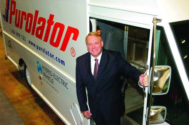 COSTLY TECHNOLOGY: Robert Johnson, president and CEO of Purolator shows off one of the company's hybrid delivery trucks.