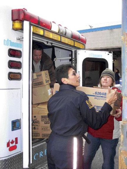GOOD CAUSE: Volunteers from St. John Ambulance brave the cold to load a tractor-trailer full of medical supplies.Photo by Adam Ledlow