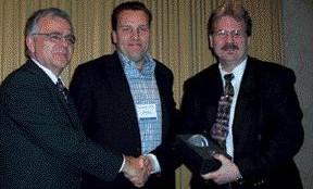 CONGRATS: Dennis Rogoza and Tim Haig congratulate Ken Fryer of the City of Coquitlam for winning a Biodiesel Fleet Manager award.